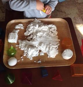 Kinetic Sand and Geometric shapes.